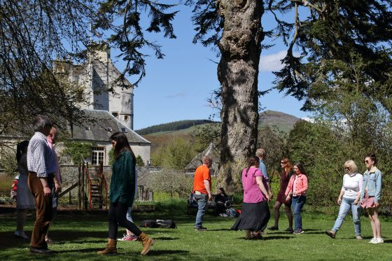 Rehearsing dancing in the beautiful grounds of Traquair House