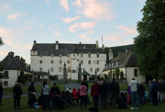 Audience and Traquair House on a beautiful evening